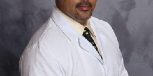 Dr. CHRISTOPHER E. HENDERSON, DDS