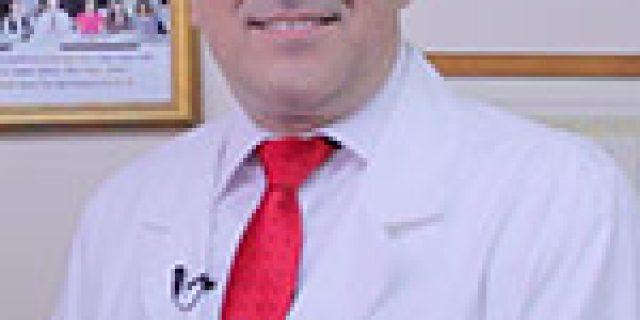 Dr. JESUS E. MARTINEZ, DDS
